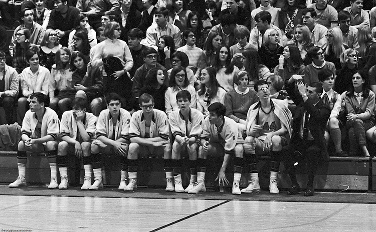 Bethel Park PA:  A view of the bench during a game against the Mt Lebanon Blue Devils at Bethel Park Gymnasium.  The JV Team was coached by Mr. Reno and the Bethel Park JVs won the Section Championship.  The team included; Scott Streiner, Steve Zemba, John Klein, Mike Stewart, Bruce Evanovich, Jeff Blosel, and Tim Sullivan.  Others in the stands; Becky Johnson, Clark Miller, Don Troup, Skip Uhl, Glenn Eisaman, Sue Henney, Dennis Franks, Marty Emler, Janet Lynch, Mike Tarbet.
