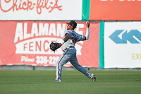 Danville Braves right fielder Charles Reyes (39) makes a throw to second base against the Burlington Royals at Burlington Athletic Stadium on July 13, 2019 in Burlington, North Carolina. The Royals defeated the Braves 5-2. (Brian Westerholt/Four Seam Images)