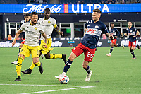 FOXBOROUGH, MA - MAY 16: Amor Traustason #25 of New England Revolution approaches the Columbus SC goal with Artur #8 Columbus SC and Jonathan Mensah #4 Columbus SC defending during a game between Columbus SC and New England Revolution at Gillette Stadium on May 16, 2021 in Foxborough, Massachusetts.