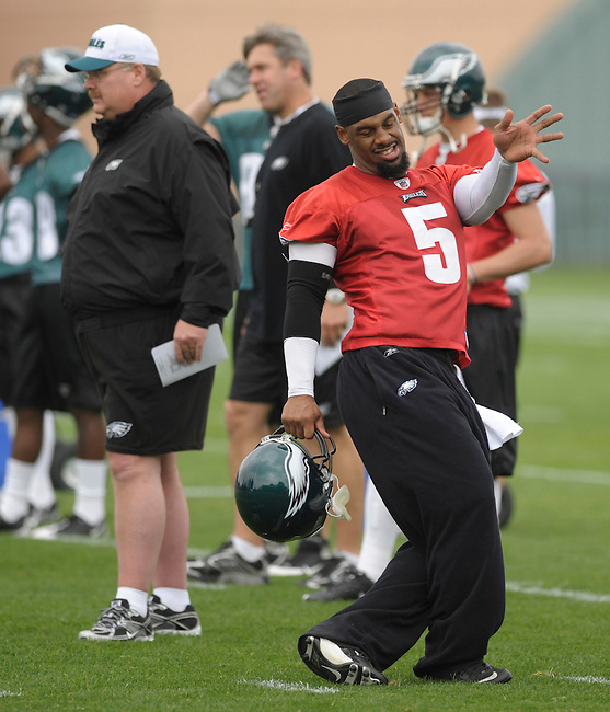 Philadelphia Eagles quarterback Donovan McNabb, right, takes some dance steps on the sideline  during the first mini-camp for all rookies and veterans at the team's Nova-Care Complex Friday, May 1, 2009, in Philadelphia. Eagles coach Andy Reid is at left. (AP Photo/Bradley C Bower)