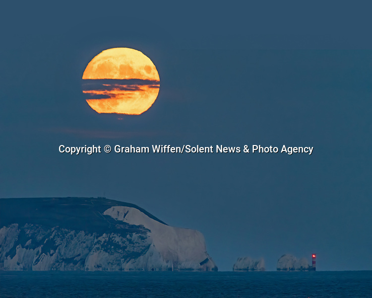 Pictured: A Corn Moon, rising over the 'Polar Bear' on the Isle of Wight, otherwise known as the Needles.<br /> <br /> Last nights full moon, is being known as the Corn Moon or the Barley Moon, which was observed by Graham Wiffen with a view across the Solent from Hengistbury Head, Dorset.  This years Harvest falls in October.<br /> <br /> Please byline: Graham Wiffen/Solent News<br /> <br /> © Graham Wiffen/Solent News & Photo Agency<br /> UK +44 (0) 2380 458800