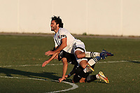RICHMOND, VA - SEPTEMBER 30: Graham Smith #16 of North Carolina FC is upended by Kenny Hot #76 of New York Red Bulls II during a game between North Carolina FC and New York Red Bulls II at City Stadium on September 30, 2020 in Richmond, Virginia.