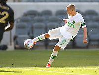 LOS ANGELES, CA - APRIL 17: Alex Ring #8  of Austin FC takes a shot during a game between Austin FC and Los Angeles FC at Banc of California Stadium on April 17, 2021 in Los Angeles, California.