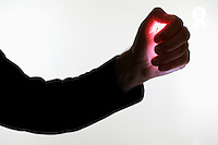 Silhouette of man's arm with glowing palm (Licence this image exclusively with Getty: http://www.gettyimages.com/detail/sb10068346br-001 )