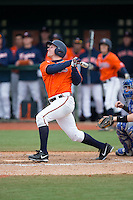 Charlie Cody (12) of the Virginia Cavaliers follows through on his swing against the Seton Hall Pirates at The Ripken Experience on February 28, 2015 in Myrtle Beach, South Carolina.  The Cavaliers defeated the Pirates 4-1.  (Brian Westerholt/Four Seam Images)