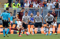 Calcio, Serie A: Roma vs Juventus. Roma, stadio Olimpico, 30 agosto 2015.<br /> Roma's Edin Dzeko, second from left, is challenged, from third from left, by Juventus' Simone Padoin, Stephan Lichsteiner and Leonardo Bonucci during the Italian Serie A football match between Roma and Juventus at Rome's Olympic stadium, 30 August 2015.<br /> UPDATE IMAGES PRESS/Riccardo De Luca