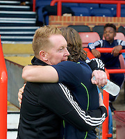 Manager Garry Waddock of Aldershot Town greets Manager Gareth Ainsworth of Wycombe Wanderers before the Friendly match between Aldershot Town and Wycombe Wanderers at the EBB Stadium, Aldershot, England on 26 July 2016. Photo by Alan  Stanford.