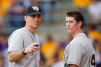 Wake Forest Demon Deacons head coach Tom Walter #32 and second baseman Conor Keniry #14 during their game against the LSU Tigers at Alex Box Stadium on February 19, 2011 in Baton Rouge, Louisiana.  The Tigers defeated the Demon Deacons 4-3.  Photo by Brian Westerholt / Four Seam Images