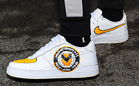 NEWPORT, WALES - FEBRUARY 16: A Fan of Newport County hand painted Nike Trainers on show prior to  kick off for the FA Cup Fifth Round match between Newport County and Manchester City at the Rodney Parade on February 16, 2019 in Newport, Wales. (Photo by Athena Pictures/Getty Images)