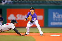 Louisville Bats shortstop Emmanuel Burriss #9 takes a pick off throw as Tony Sanchez dives back to second during a game against the Indianapolis Indians on April 19, 2013 at Louisville Slugger Field in Louisville, Kentucky.  Indianapolis defeated Louisville 4-1.  (Mike Janes/Four Seam Images)