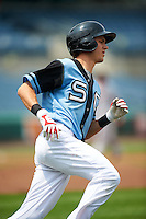 Syracuse Chiefs shortstop Trea Turner (4) runs to first during a game against the Pawtucket Red Sox on July 6, 2015 at NBT Bank Stadium in Syracuse, New York.  Syracuse defeated Pawtucket 3-2.  (Mike Janes/Four Seam Images)