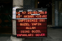 Sign outside a mosque giving details of the next prayer (namaz) time, Istanbul, Turkey. Also with a message saying that God loves those that do their appointed job well