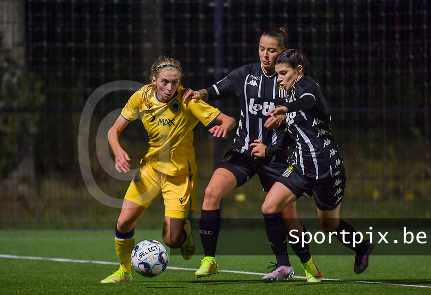 Ludmila Matavkova (9) of Club Brugge pictured in a duel with Alysson Duterne (14) of Sporting Charleroi and Manola Galofaro (10) of Sporting Charleroi during a female soccer game between Sporting Charleroi and Club Brugge YLA on the sixth matchday in the 2021 - 2022 season of Belgian Scooore Womens Super League , friday 8 October 2021 in Marcinelle , Belgium . PHOTO SPORTPIX   STIJN AUDOOREN