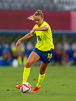 TOKYO, JAPAN - JULY 21: Fridolina Rolfo #18 of the USWNT dribbles during a game between Sweden and USWNT at Tokyo Stadium on July 21, 2021 in Tokyo, Japan.