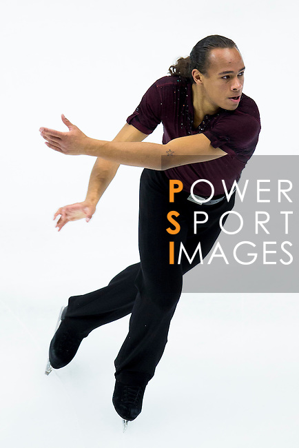 TAIPEI, TAIWAN - JANUARY 22:  Elladj Balde of Canada competes in the Men Short Program event during the Four Continents Figure Skating Championships on January 22, 2014 in Taipei, Taiwan.  Photo by Victor Fraile / Power Sport Images *** Local Caption *** Elladj Balde