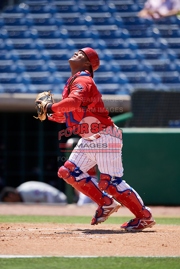 Clearwater Threshers catcher Wilson Garcia (10) settles under a pop up during a game against the Fort Myers Miracle on April 25, 2018 at Spectrum Field in Clearwater, Florida.  Clearwater defeated Fort Myers 9-5. (Mike Janes/Four Seam Images)