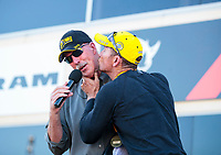 Sep 15, 2019; Mohnton, PA, USA; NHRA funny car driver Jack Beckman (right) kisses announcer Alan Reinhart after winning the Reading Nationals at Maple Grove Raceway. Mandatory Credit: Mark J. Rebilas-USA TODAY Sports