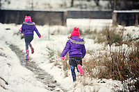 Jessica, 7, and Michaela,5, Adamson play in the fresh snow in the village of Coelbren in the Swansea Valley in South Wales.