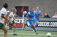 Angela Hucles sprints past Athletica players. Saint Louis Athletica defeated the Boston Breakers 1-0 in Cambridge, Massachusetts on June 14, 2009.