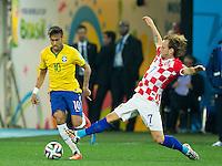 Neymar of Brazil takes on Ivan Rakitic of Croatia