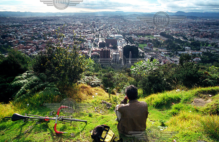 A cyclist takes a break and admires the view of the capital.