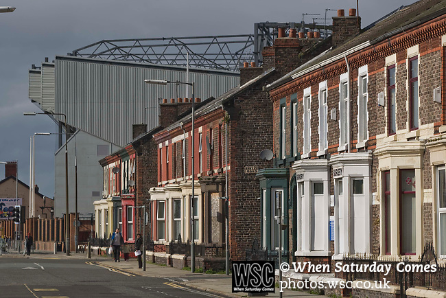 A street adjacent to Anfield, home of Liverpool football club, showing the Kop stand in the background. The club was one of the most successful and best supported teams in England and which won many domestic and European trophies. The most-famous part of the stadium was the Kop, where the Liverpool fans sat during games. Photo by Colin McPherson