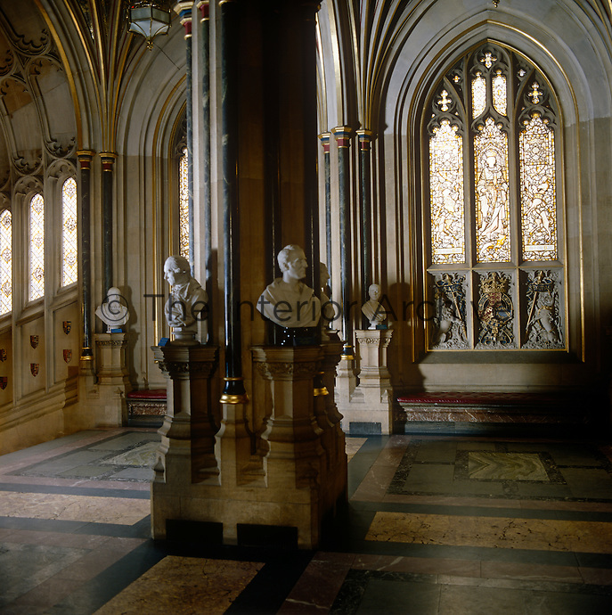 The Norman Porch, with busts of noble Prime Ministers and a window showing Queen Victoria, in whose reign the present Palace of Westminster was built