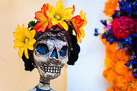 A flower-decorated skeleton figure is seen placed in the street during the Day of the Dead celebrations in Oaxaca, Mexico, 30 October 2019. Day of the Dead (Día de Muertos), a religious holiday combining the death veneration rituals of Pre-Hispanic cultures with the Catholic practice, is widely celebrated throughout all of Mexico. Based on the belief that the souls of the departed may come back to this world on that day, people gather together while either praying or joyfully eating, drinking, and playing music, to remember friends or family members who have died and to support their souls on the spiritual journey.
