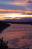 Smokefilled skies enhance the sunset along the Madison river, West Entrance Road, Yellowstone.