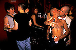 'GAYFEST MANCHESTER, UK', OPEN MOUTH, OPEN EYE, DRINK FUELLED REVELLERS EMBRACE AT THE HOLLYWOOD SHOWBAR, 1999