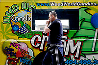 NEW YORK - NEW YORK - MARCH 25: A man crosses in front of Weed World Candies truck on March 25, 2021 in New York. New York State reach a deal to legalize recreational marijuana, and open a way for a almost $4.2 billion industry that could create  thousands of jobs.. (Photo by Emaz/VIEWpress)