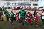 The Irish team run out to take on Wales.<br /> 6 Nations Championship<br /> Wales v Ireland Women<br /> St Helens Swansea<br /> 15.03.15<br /> ©Steve Pope - SPORTINGWALES