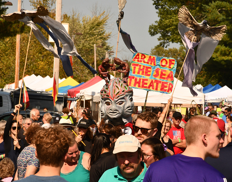 Members of the ARM-of-the-SEA Theater, seen parading through Cantine Field before the start of their performance of a Puppet Suite, on the Bandstand Stage, during the 2019 Hudson Valley Garlic Festival, sponsored by the Kiwanis Club of Saugerties, and held at Cantine Field, in Saugerties, N.Y., on Saturday, September 28, 2019. Photo by Jim Peppler. Copyright Jim Peppler/2019.
