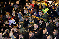 Lincoln City fans watch their team in action<br /> <br /> Photographer Chris Vaughan/CameraSport<br /> <br /> The EFL Sky Bet League One - Lincoln City v Milton Keynes Dons - Tuesday 11th February 2020 - LNER Stadium - Lincoln<br /> <br /> World Copyright © 2020 CameraSport. All rights reserved. 43 Linden Ave. Countesthorpe. Leicester. England. LE8 5PG - Tel: +44 (0) 116 277 4147 - admin@camerasport.com - www.camerasport.com
