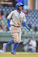 Lexington Legends right fielder Khalil Lee (9) walks to first base during a game against the Greenville Drive at Fluor Field at West End on April 10, 2017 in Greenville, South Carolina. The Legends defeated the Drive 12-4 (Tony Farlow/Four Seam Images)
