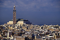 Casablanca, Morocco - Satellite Dishes Cover the Rooftops in the Medina of Casablanca, Mosque of Hassan II in Background.