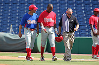 Philadelphia Phillies outfielder Zach Collier #8 is escorted off the field by manager Mickey Morandini #12 and trainer Troy Hoffert after an injury during an Instructional League game against the Detroit Tigers at Brighthouse Field on October 5, 2011 in Clearwater, Florida.  (Mike Janes/Four Seam Images)