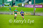 Seanie Brosnan of St Brendan's races ahead of Sean Weir of Crotta to gain possession in the County Senior Hurling Championship quarter final