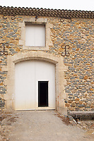 Chateau Grand Moulin. In Lezignan-Corbieres. Les Corbieres. Languedoc. A door. France. Europe.