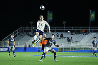 CARY, NC - DECEMBER 15: Joe Bell #8 of University of Virginia wins a header over Jack Beer #11 of Georgetown University during a game between Georgetown and Virginia at Sahlen's Stadium at WakeMed Soccer Park on December 15, 2019 in Cary, North Carolina.