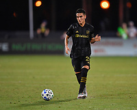LAKE BUENA VISTA, FL - JULY 18: Eduard Atuesta #20 of LAFC passes the ball during a game between Los Angeles Galaxy and Los Angeles FC at ESPN Wide World of Sports on July 18, 2020 in Lake Buena Vista, Florida.