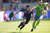SAN JOSE, CA - SEPTEMBER 30: Cristian Espinoza #10 of the San Jose Earthquakes is marked by Brad Smith #11 of the Seattle Sounders FC during a Major League Soccer (MLS) match between the San Jose Earthquakes and the Seattle Sounders on September 30, 2019 at Avaya Stadium in San Jose, California.
