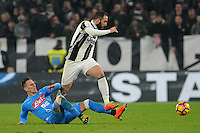 Calcio, semifinale di andata di Tim Cup: Juventus vs Napoli. Torino, Juventus Stadium, 28 febbraio 2017.<br /> Juventus' Gonzalo Higuain, right, is tackled by Napoli's Arkadiusz Milik during the Italian Cup semifinal first leg football match between Juventus and Napoli at Turin's Juventus stadium, 28 February 2017.<br /> UPDATE IMAGES PRESS/Manuela Viganti