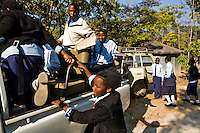 Students from grades 8 and 9 at Kafinda basic school in Sereje district, near Kasanka National Park, venture out on their first safari. Local schools and women's groups are regularly brought into Kasanka, which is unique in the country and unusual in Africa as it is privately managed and owned by a trust. People are able to see animals flourishing in land which was once free reign for poachers. Combined with anti-poaching scouts, the education programme is on the frontline of conservation methods in the park, showing local people wild animals in their natural habitat.