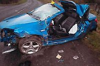 "Pictured: The scene of the crash near AMmanford, west Wales, UK.<br /> Re: Disqualified motorist Nathan Anderson, who fled the scene of an horrific crash and left his seriously ill friend Nicholas Spowart for dead, has been jailed by Swansea Crown Court in Wales, UK.<br /> Anderson, from Cwmllynfell, lost control of his girlfriend's car near Ammanford after driving at high speeds in the early hours of the morning.<br /> The blue Vauxhall Tigra crashed into a bank before being launched into the air and landing in a crumpled wreck.<br /> Anderson, 23, who was already on bail for drug driving, fled the scene without checking on his friend in the wreckage or even calling 999.<br /> The court heard that it was only by chance that a police car was driving along the road at 2.30am and found passenger Nicholas Spowart gravely ill.<br /> When police officers tracked down the defendant, he pulled a knife and threatened to harm himself.<br /> Mr Spowart was cut from the wreckage by firefighters before being taken to hospital with ""life-changing"" injuries.<br /> For causing serious injury by dangerous driving Anderson was jailed for three-and-a-half years, and for possession of the bladed article to two months, to run consecutively making a total sentence of three years and eight months."