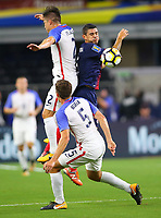 ARLINGTON, TEXAS - Saturday July 22, 2017: Jorge Villafaña #2 of USMNT and Matt Besler #5 defend the ball against the Costa Rican National Team in the first half of the match at AT&T Stadium.