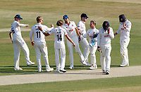 Essex players congratulate Simon Harmer on taken the wicket of Adam Finch during Essex CCC vs Surrey CCC, Bob Willis Trophy Cricket at The Cloudfm County Ground on 9th August 2020