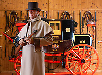 BNPS.co.uk (01202 558833)<br /> Pic: PhilYeomans/BNPS<br /> <br /> Restorer and carriage driver Mark Broadbent, complete with the Royal Mail Blunderbuss carried by the Guard, has spent two years completely rebuilding the historic vehicle.<br /> <br /> Last Post - Britain's last Royal Mail carriage, that bizarrely once survived an attack by a lion outside Salisbury, has been saved for the nation.<br /> <br /> The 200-year-old horse-drawn carriage harks back to the golden age of the Royal Mail when crowds gathered along the route to see the lightning-quick service thunder by.<br /> <br /> The restored four horse coach was known as 'Quicksilver' as it was the fastest in the land on its regular 21 hour run from Devonport, Devon, to London.<br /> <br /> But the red and black wooden wagon went down in history for an extraordinary incident involving a lion in the English countryside in 1816.