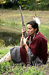 Native American Lakota Sioux Indian woman holding a rifle on lookout