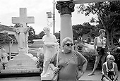 Memphis, Tennessee<br /> USA<br /> August 12, 2002<br /> <br /> Elvis Presley's fans from around the world visit the grave of Elvis at sunrise a few days before the 25th anniversary of his death.